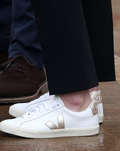 A shoe detail of the Duchess of Cambridge's white Veja sneakers during the meeting with local fishermen and their families in Fife, Scotland on May 26, 2021.