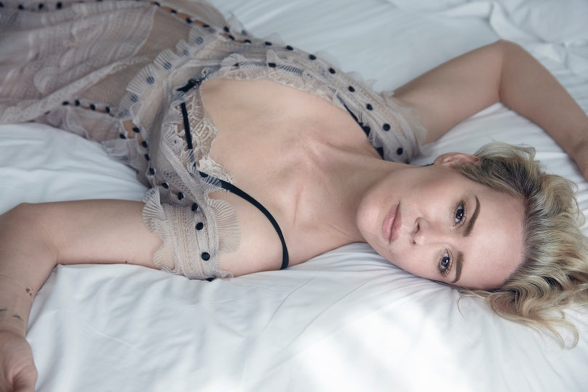 Sarah Paulson sprawled out in bed