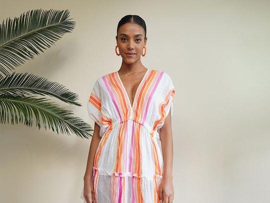 woman wearing pastel striped dress for breastfeeding