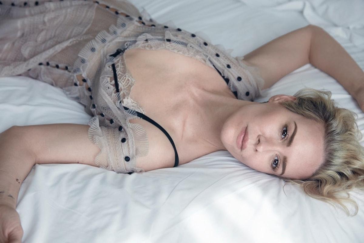 Sarah Paulson sprawled on a bed