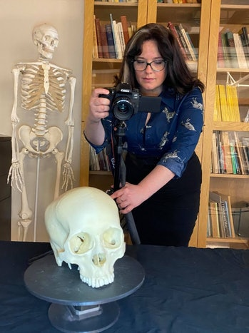 scientists taking photos of a skull for 3d model of anglo-saxons