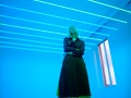 Young woman in neon blue lights to describe what planet rules Tuesday, what planet rules Wednesday, ...