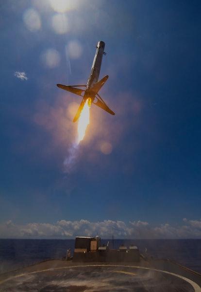 Falcon 9 rocket landing on drone ship at sea