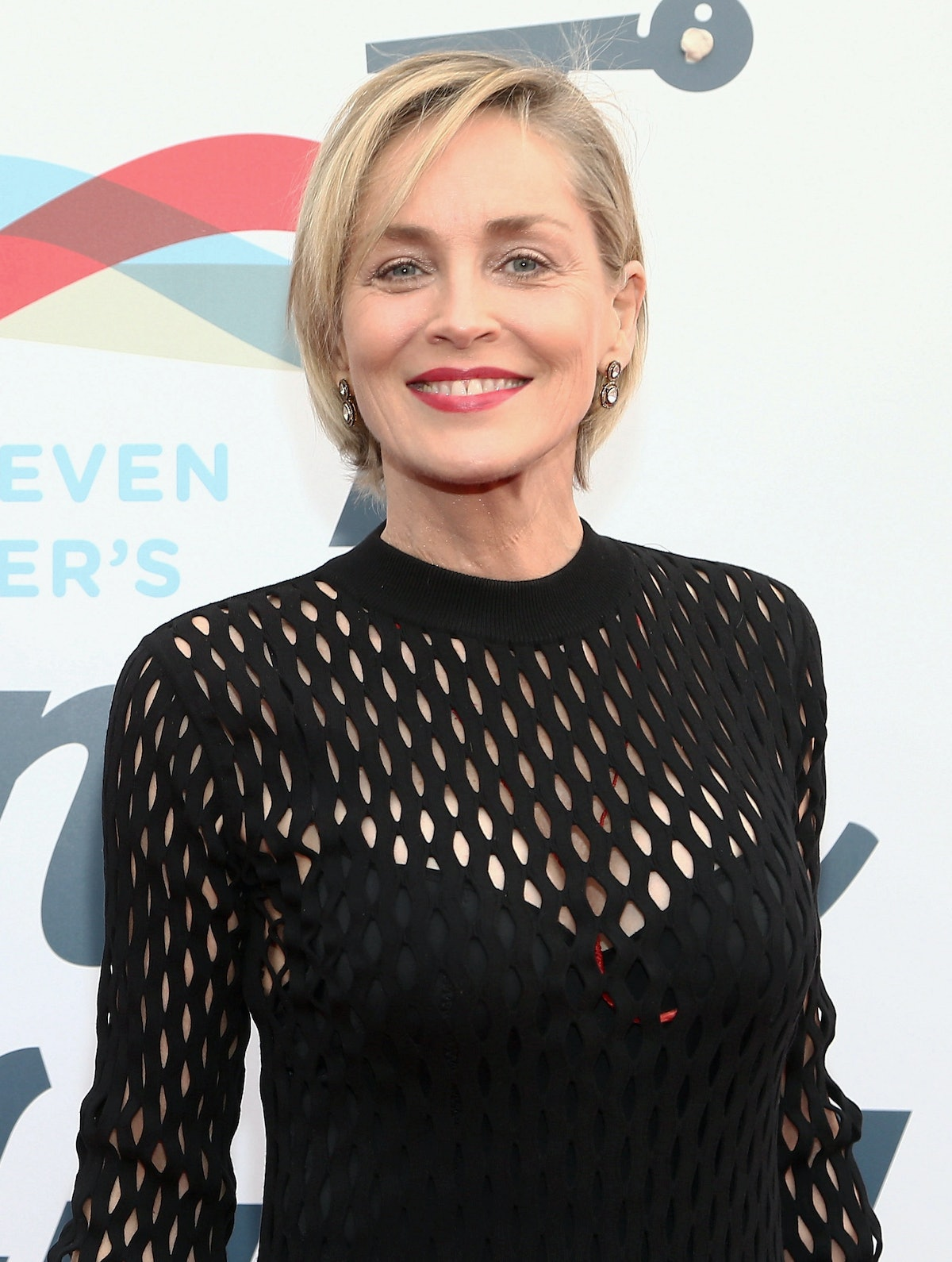 Sharon Stone smiling on the red carpet