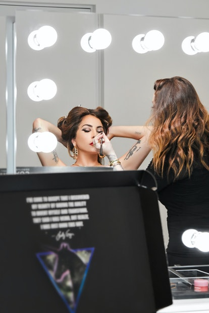 Bustle exclusive: A behind-the-scenes shot of Lady Gaga's latest Haus Labs campaign.