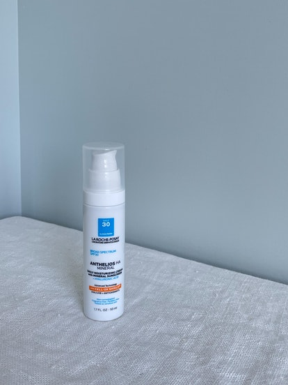 a photo of the sunscreen on a linen blanket