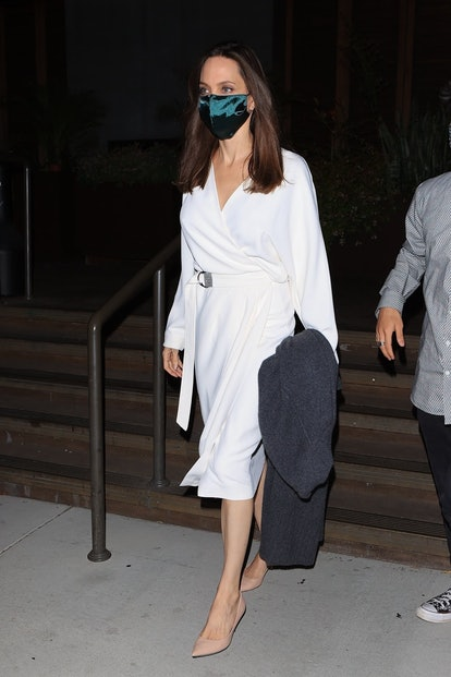 Angelina Jolie wearing a wrap dress to dinner.