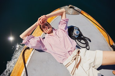 woman on boat in striped shirt