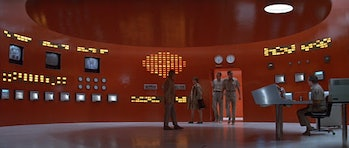A team of scientists in a red control room in The Andromeda Strain