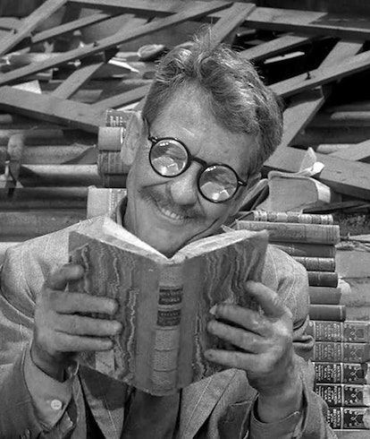 man with glasses reading book in still from the twilight zone series