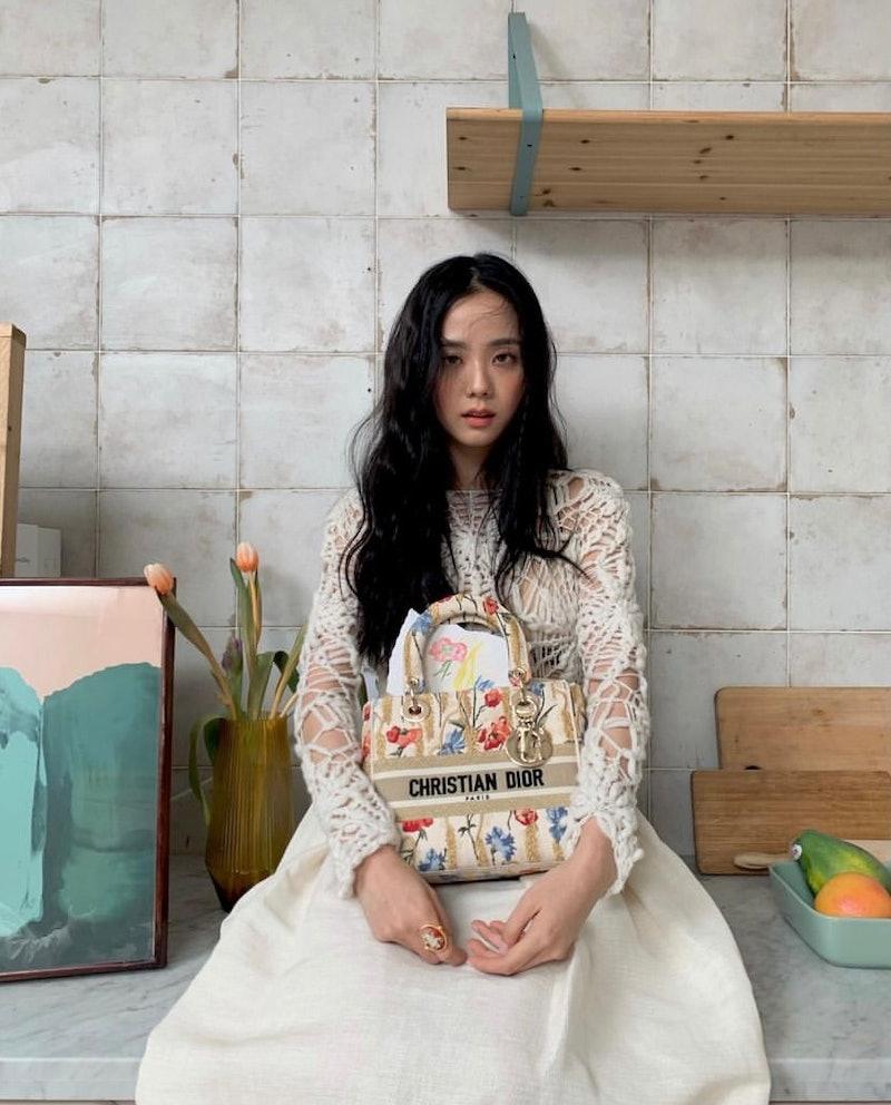 Blackpink's Jisoo carries a Dior bag.