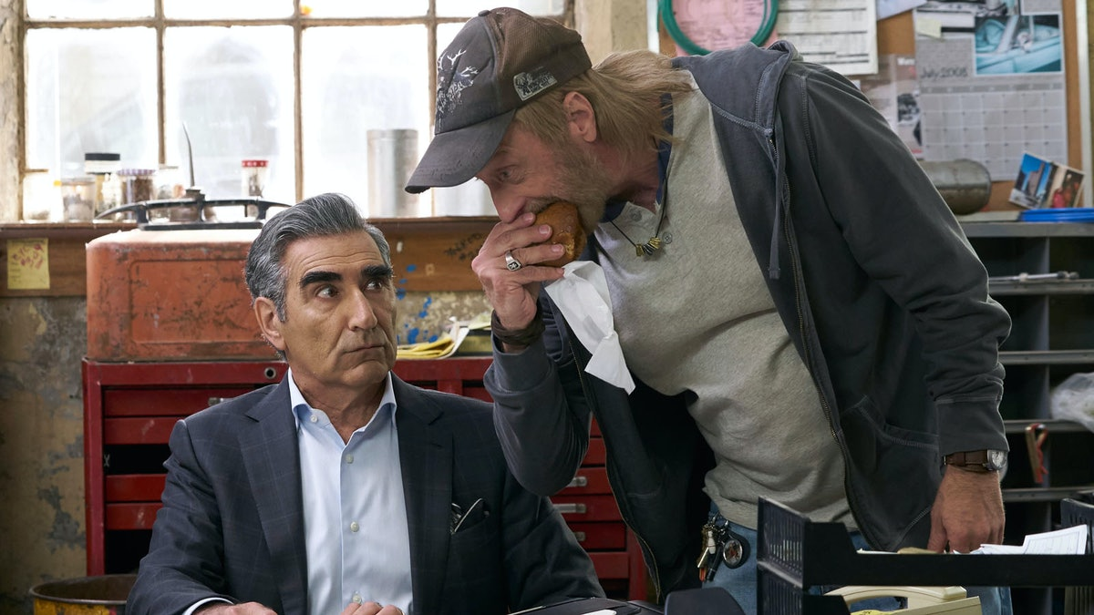 Johnny Rose (Eugene Levy) dealing with Roland in 'Schitt's Creek.'