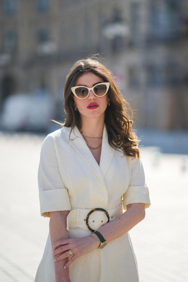 Woman wearing sunglasses and a dress in the sun