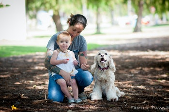 Parent with child and dog