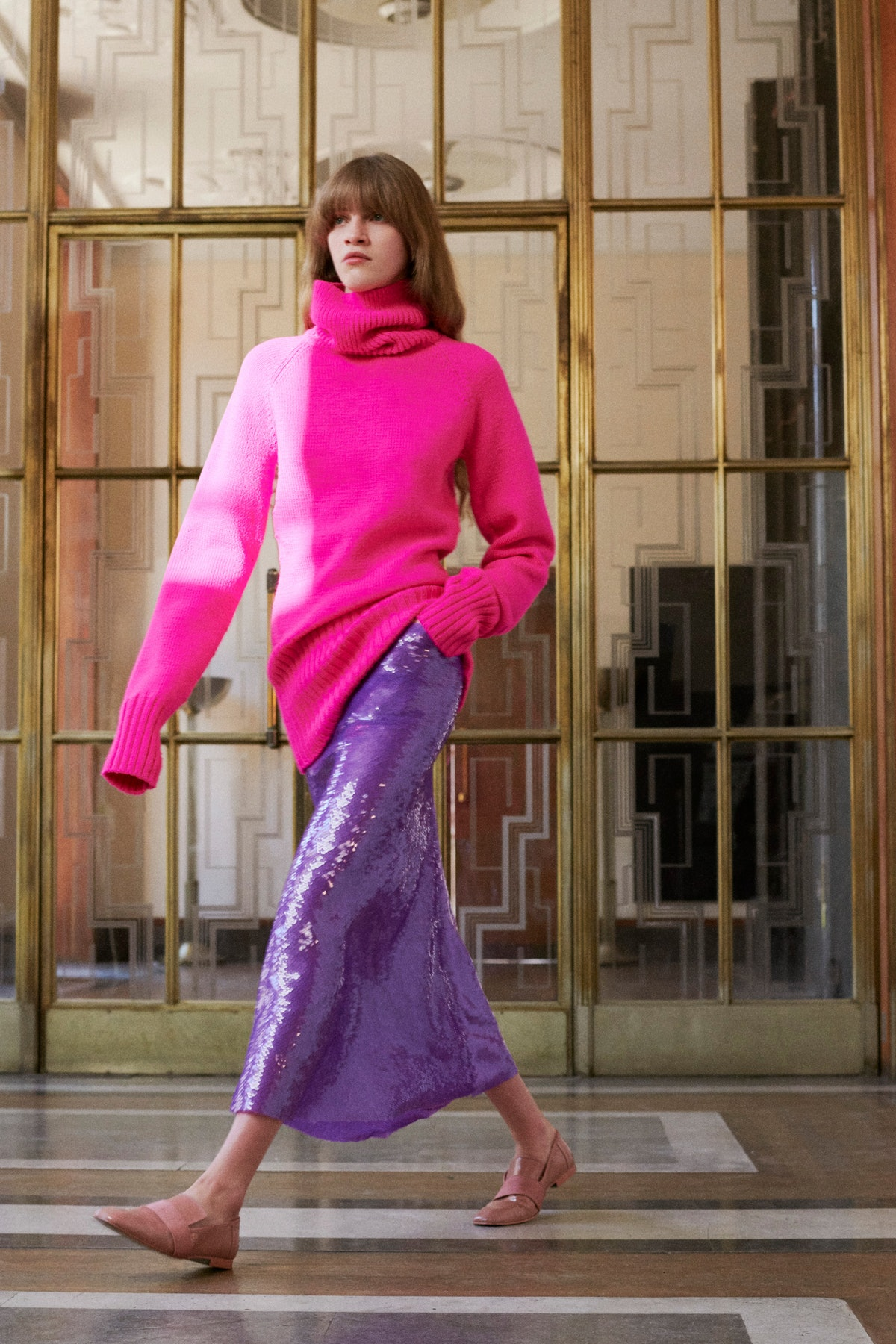 model in pink sweater and purple sequin skirt