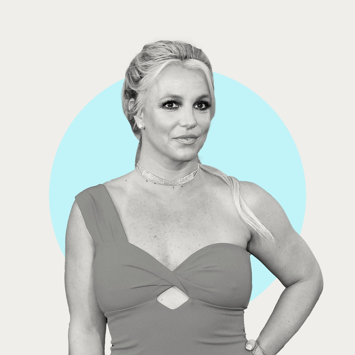 Britney Spears seen posing for the camera, in black and white on a blue background