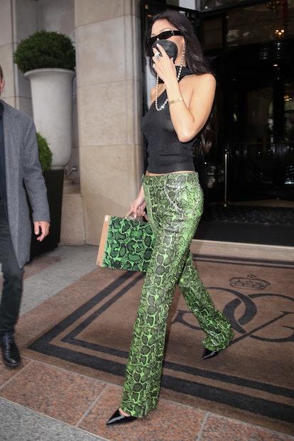 Bella Hadid wearing a matching pant and handbag combo in Paris 2021.