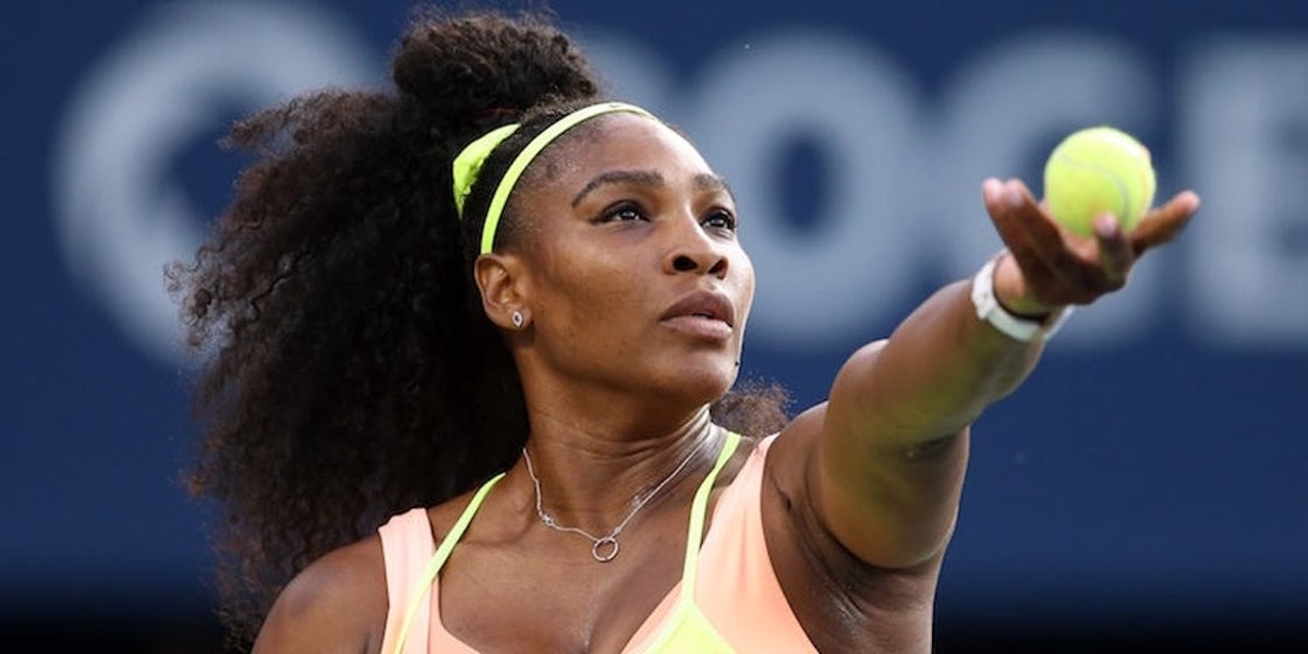 Serena Williams playing tennis, who said she won't be at the 2021 Olympics.