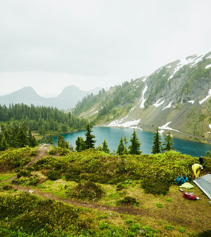 Beautiful places to go camping; small tent on campsite in mountains/forest