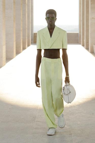 A model wearing a Fendi men's spring 2022 crop top