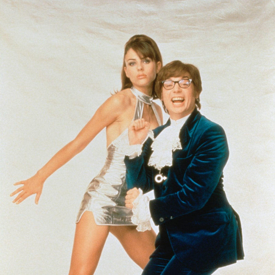 British actress and model Elizabeth Hurley and canadian actor, screenwriter and producer Mike Myers on the set of 'Austin Powers: International Man of Mystery.'