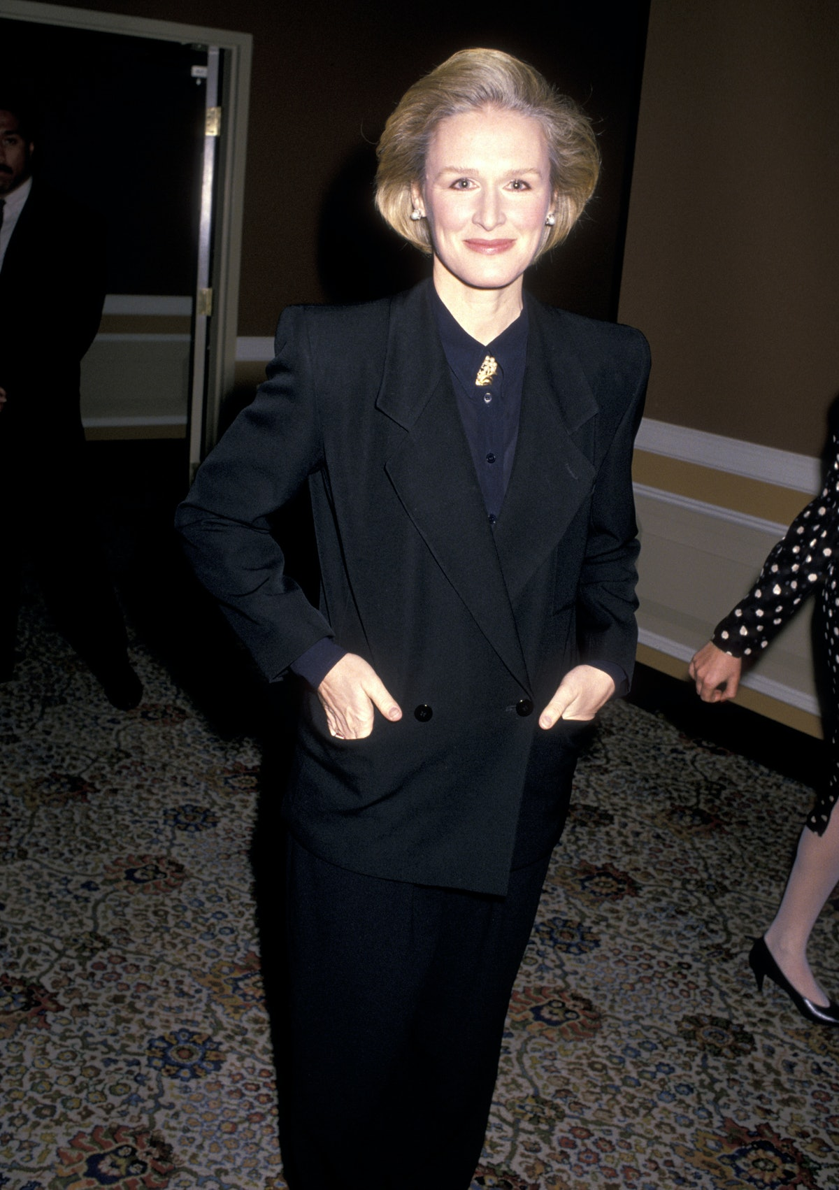 Glenn Close with hands in pockets