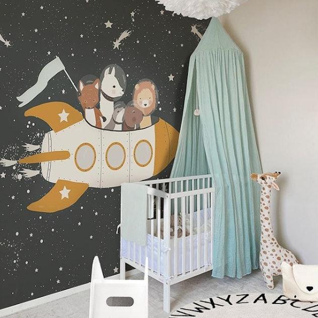 Space-themed wallpaper in baby nursery