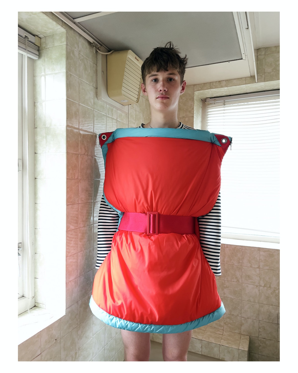 A model wearing a pillowy JW Anderson look from men's spring 2022