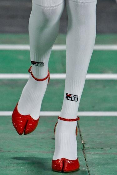 A model wearing Y/Project x Fila's lobster claw-like shoes