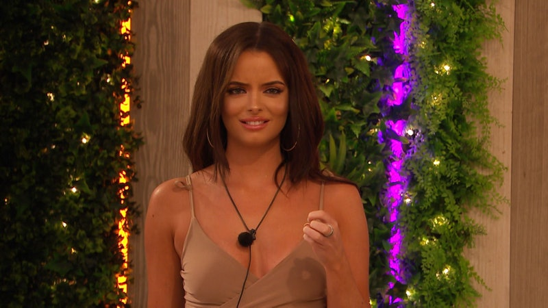 Love Island's Maura with a disgruntled look on her face. She's wearing a beige vest top