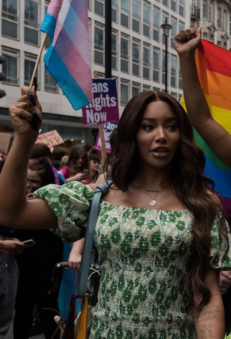 Activist and model Munroe Bergdorf waves a trans flag at london trans+ pride 2021