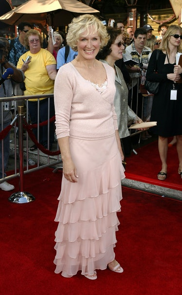 Glenn wears a blush pink sweater and tulle skirt
