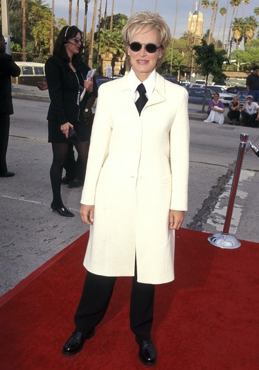 Glenn wears white jacket over suit and tie