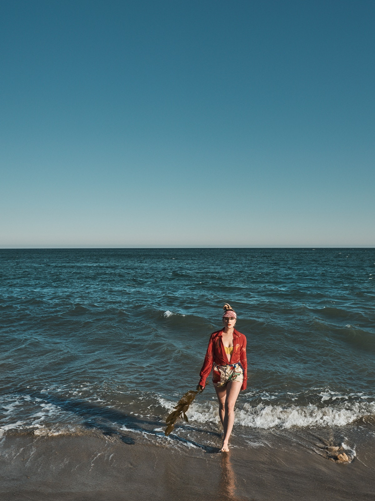 Annie Murphy, star of 'Schitt's Creek' & 'Kevin Can F*ck Himself,' stands in the water at the beach ...
