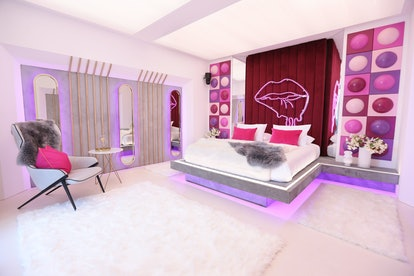 The hideaway featuring pink, red and, purple decor