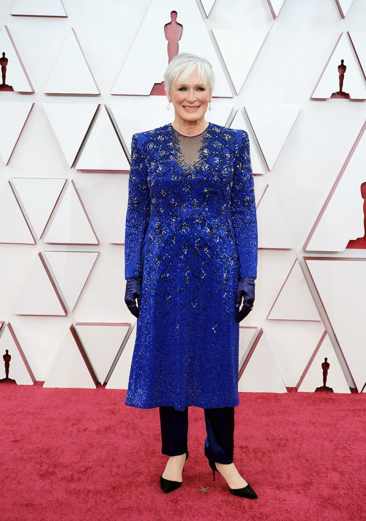 Glenn wears blue gown