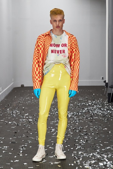 A model wearing skin-tight yellow vinyl Lazoschmidl pants