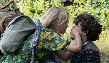 Emily Blunt placing her hand overNoah Jupe's mouth
