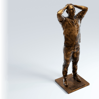 Public.com bronze Elon Musk statuette photo