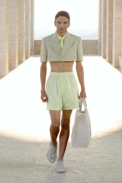 A model wearing a Fendi men's spring 2022 mini cropped blazer