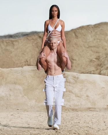 Joan Smalls atop a model's shoulders at Burberry men's spring 2022