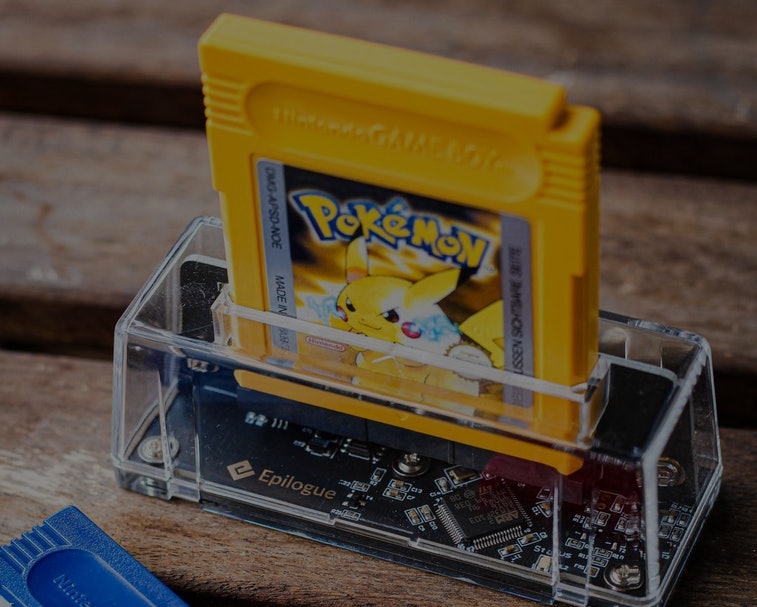 Pokemon yellow inserted into a GB Operator from Epilogue
