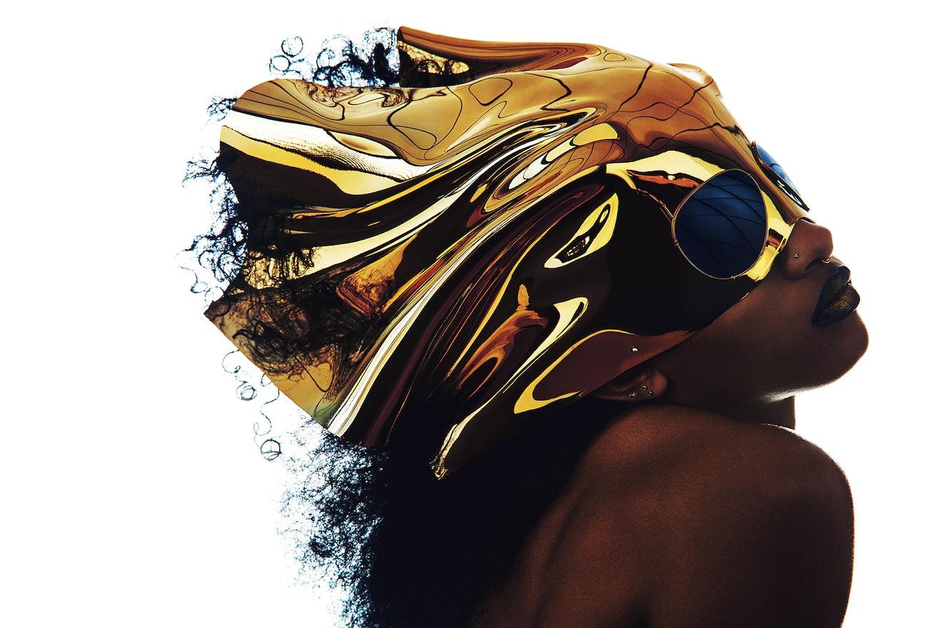 NYLON cover star Willow Smith wears a gold Schiaparelli headpiece.