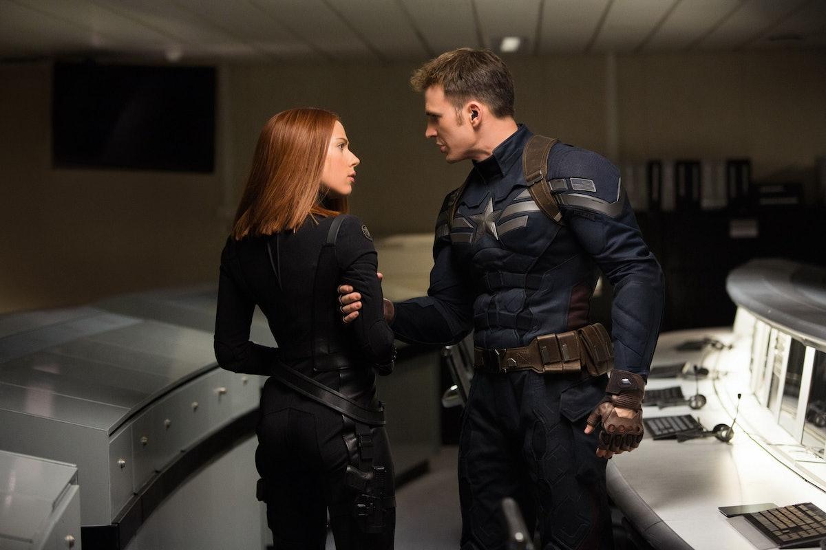 Scarlett Johansson as Black Widow with Chris Evans as Steve Rogers, preparing to go on the run in Ca...