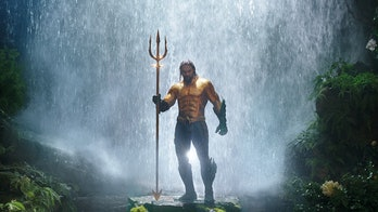 Jason Momoa gold suit and waterfall in Aquaman