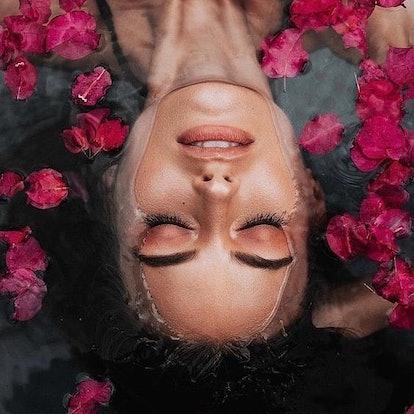 Saint Jane Beauty model in rose petal bath