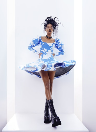 Willow Smith poses for NYLON's cover wearing a long-sleeved blue and white dress by Puppets Puppets.