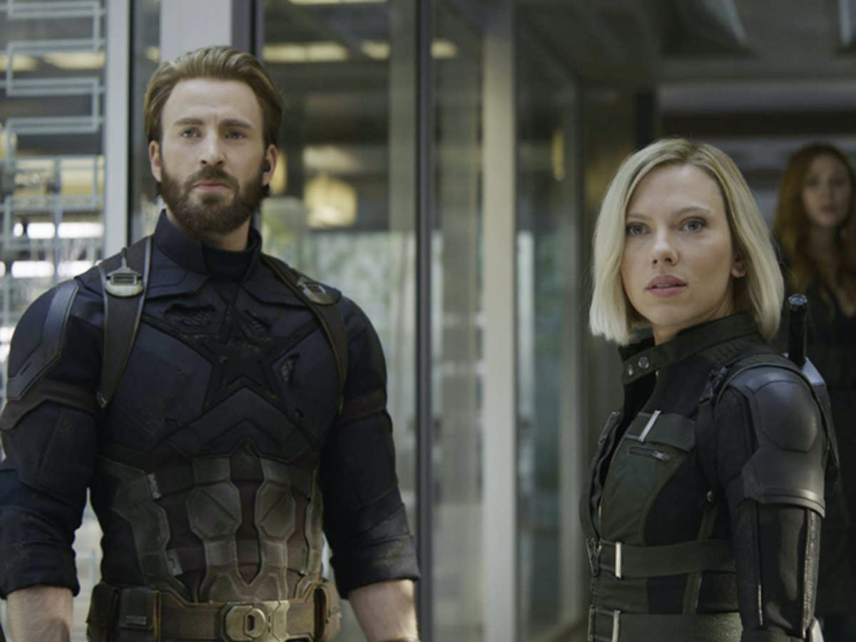 Scarlett Johansson as Black Widow with Chris Evans as Steve Rogers, returning from on the run in Ave...