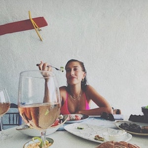Hailey Bieber wears pink Maia Mysa bikini from TRIANGL while on vacation in Greece with her husband,...