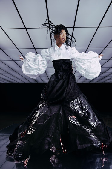 Willow Smith poses for NYLON's cover wearing a floor-length black and white Thom Browne dress.